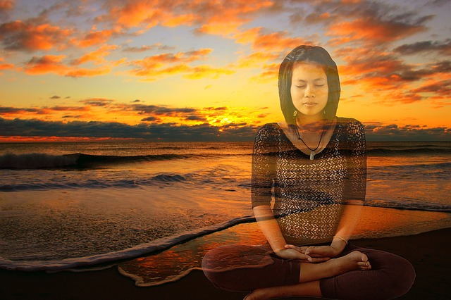 Girl meditating with beach scene in background